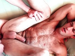Hairy cutie on his back with a cock in his asshole tubes