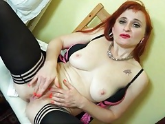 Redheaded mom with a hot body masturbates tubes