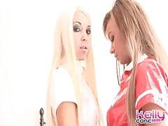Latex nurses in white stockings share lovely kisses tubes