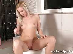 Pure beauty with perky breasts plays with toys tubes