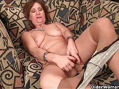 Classy old lady strips to play with her pussy tubes