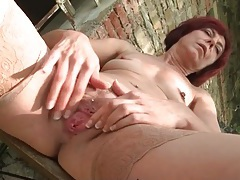 Pretty redhead mom has fun masturbating outdoors tubes