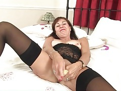 Lingerie mom fucks her cunt with a peeled banana tubes