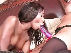 Black lesbian sensually sucks on strapon tubes