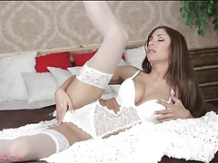 Dreamy white lace lingerie on a babe in bed tubes