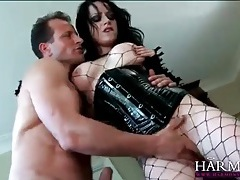 Sexy goth babe in a latex corset sucks his dick tubes
