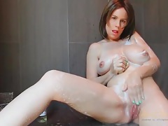Busty mom gets clean and pisses in the shower tubes