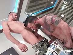 Hot guys in a hotel room blow each other tubes