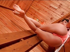 Bikini girl in the sauna has sexy feet tubes