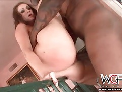 Black dude bends her over a railing and fucks her hole tubes