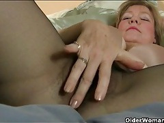 Sexy old broad in pantyhose plays with her cunt tubes