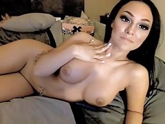 Busty cam babe tries on a tight top to tease you tubes