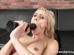 Stockings slut takes a toy in her ass while pissing tubes