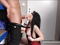Slut in a sexy dress blows a business man tubes