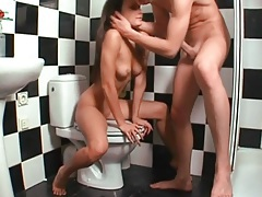 Toe fucking the cute slut on the toilet tubes