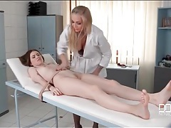 Busty doctor straps her patient to a table tubes