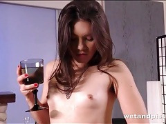 Hairy armpits girl fills a glass with pee tubes