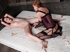 Mistress in elegant lingerie fills a slut with a big dildo tubes