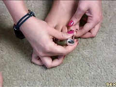 Pretty feet girl paints her toenails purple tubes
