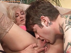 Old cougar wants this tattooed stud to fuck her tubes
