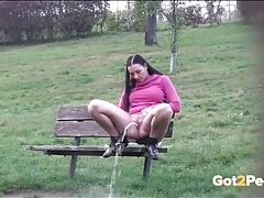 Sporty girl on a park bench takes a hot piss tubes