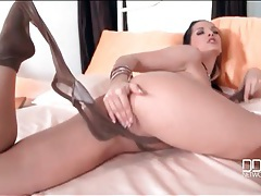 Babe on shiny satin sheets sucks her toes tubes