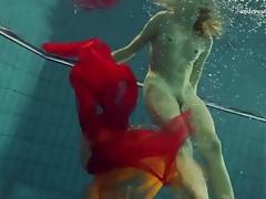 Skinny girl makes erotic underwater art tubes