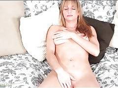 Freckled cutie with sexy lips rubs her pussy tubes