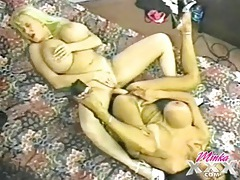 Lesbians with massive breasts share a dildo tubes
