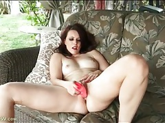 Mom with a tramp stamp fucks a toy outdoors tubes