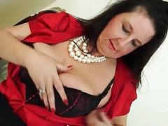 Big milf tits are sexy in a red satin blouse tubes