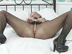 Babe pulls down her fishnet pantyhose to masturbate tubes
