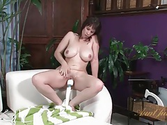 Milf has a great orgasm with her vibrator tubes
