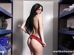 Black haired babe in a shiny dress sucks cock tubes