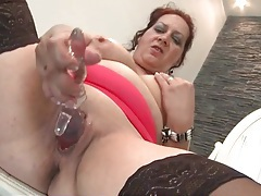 Wicked old lady fucks her bald cunt with a dildo tubes