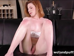 Auburn hair beauty fingers her box in close up tubes