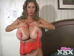 Minka models her giant pornstar tits in a hotel room tubes