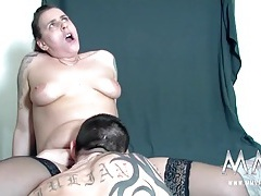 Chubby inked babe bent over a table and fucked tubes