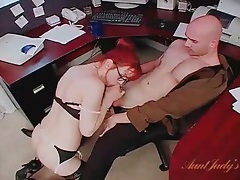 Naughty redheaded secretary in lingerie blows her boss tubes
