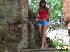 Shaved pussy girl in shorts takes a public piss tubes