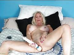 Solo milf with incredible fake tits masturbates solo tubes