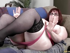 Bbw dressed up in pink lingerie fingers her cunt tubes