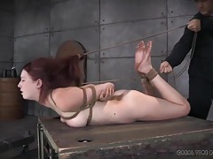 Real pain for a submissive redhead in rope bondage tubes