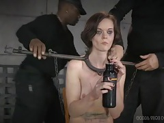 Metal bar bondage for a slender brunette beauty tubes