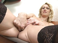Blonde slips two fingers into her mature pussy tubes