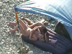 Nude beach pussy and ass eating under an umbrella tubes