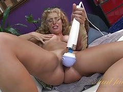 Long curly hair babe gets soaking wet with a toy tubes