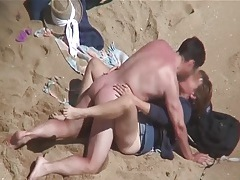 Kissing and fucking his sexy wife on the beach tubes
