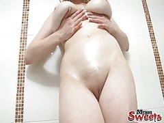 Yummy big natural tits coated in slippery oil tubes
