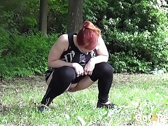 Curvy girl with a full bladder pees in public tubes